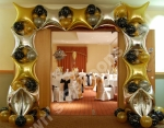 Large foil balloon arch at the room entrance. Prices from �185.00p