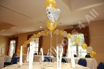 large balloon arch over the main table